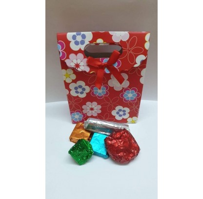 Assorted Chocolates In Cheerful Red  Paper Bag